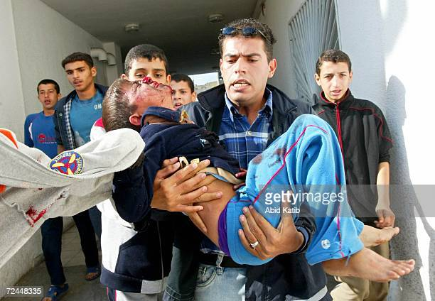 A wounded Palestinian boy is rushed in to Kamal Odwan hospital after Israeli tanks fired on homes November 8 2006 in the town of Beit Hanoun in the...