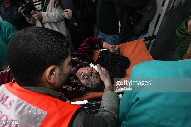 A wounded Palestinian woman is carried on a stretcher into the Kamal Adwan hospital after an Israeli air strike on January 11 2009 in Beit Lahia Gaza...