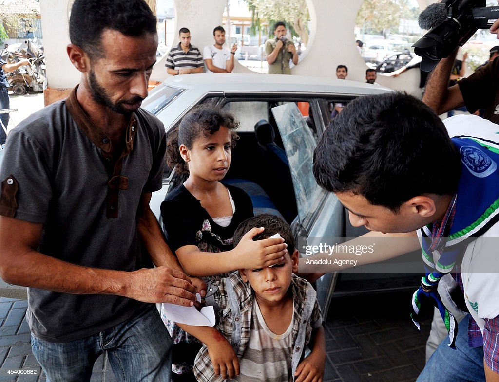 Wounded Palestinians are carried to Al-Shifa hospital after Israeli atatcks to Gaza, on August 23, 2014. Israeli army have hit 3 mosque and 30 targets for the last night. Since hostilities began on July 7, at least 2095 Palestinians have been killed in the Gaza Strip the vast majority of them were civilians while more than 10,000 have been injured by devastating Israeli army's attacks. According to Israeli figures, at least 68 Israelis, four of them were civilians killed by Palestinian rocket fire, have been killed over the same period.