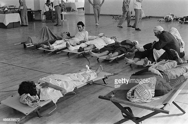 Wounded Palestinians coming from the Palestinian refugee camp of Wihdat wait at the French field hospital in Amman on October 02 1970 In September...