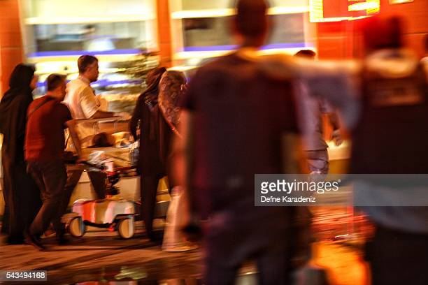 A wounded passenger is carried to the Bakirkoy Sadi Konuk Hospital as relatives of the victims wait outside the hospital in the early hours of June...