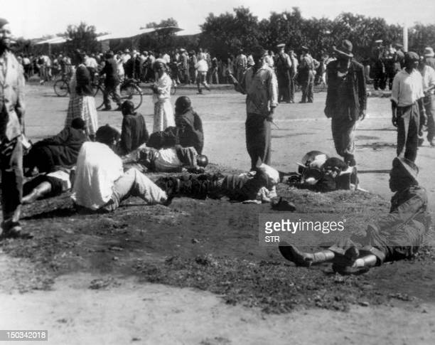 Wounded people lie in the street 21 March 1960 in Sharpeville near Vereeniging where at least 180 black Africans most of them women and children were...