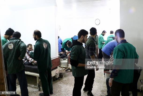 Wounded people receive treatment at a hospital after Assad regime's warplane carried out airstrikes over Arbin town of the Eastern Ghouta region in...