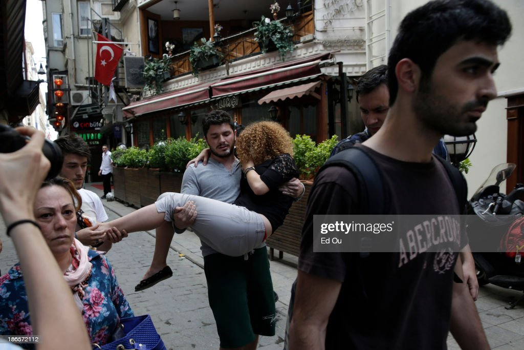 A wounded protester is carried through the streets in a day of crackdown against antigovernment protesters in Istanbul Turkey on June 16 2013 After...