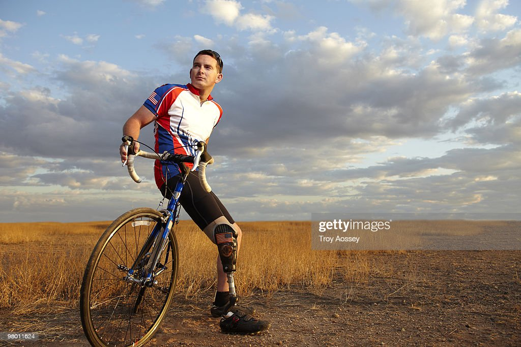 Wounded soldier with prosthetic leg and bike