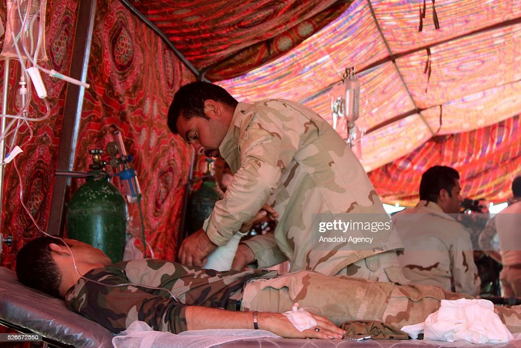 Wounded soldiers receive medical treatment after members of Peshmerga forces and Shiite Hasdi Sabi forces attack Daesh to rescue Turkmen Besir Village from Daesh in Kirkuk, Iraq on April 30, 2016.
