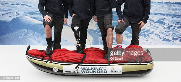 Wounded soldiers Stephen Young Guy Disney Jaco Van Gass Martin Hewitt pose for photographs in Trafalgar Square before emabrking on an expedition to...