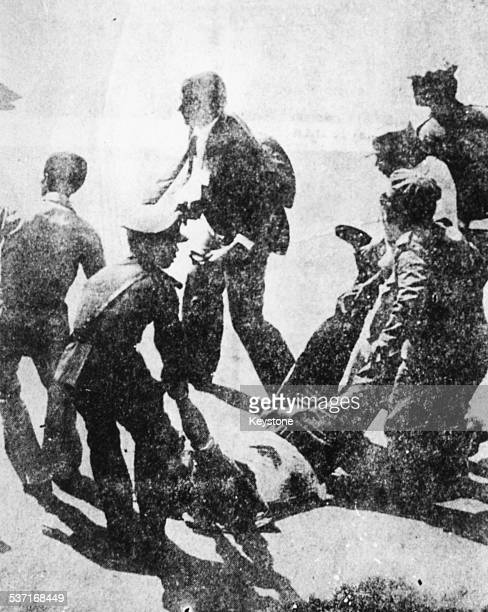 A wounded terrorist is carried away by soldiers after the assassination of Egyptian President Anwar Sadat Cairo Egypt October 1981