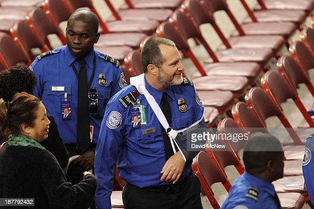 Wounded Transportation Security Administration officers Tony Grigsby and James Speer attend at a public memorial service to honor for TSA Officer...