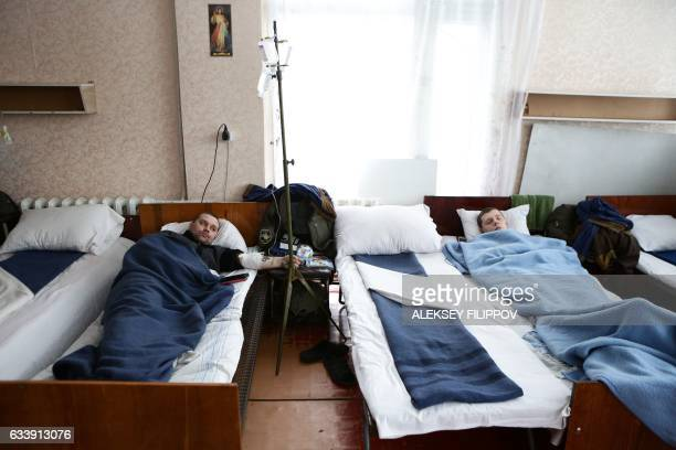 Wounded Ukrainian servicemen wait on hospital beds at the military hospital in the small town of Pokrovske near Avdiivka Donetsk region on February 5...