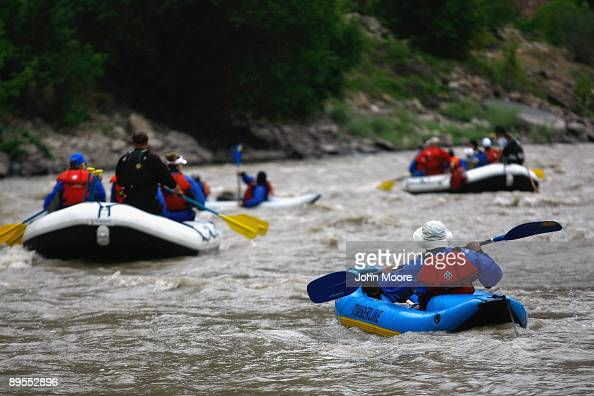 Wounded US servicemen and their families raft on the Colorado River on July 31 2009 near No Name Colorado A dozen war wounded and their families...