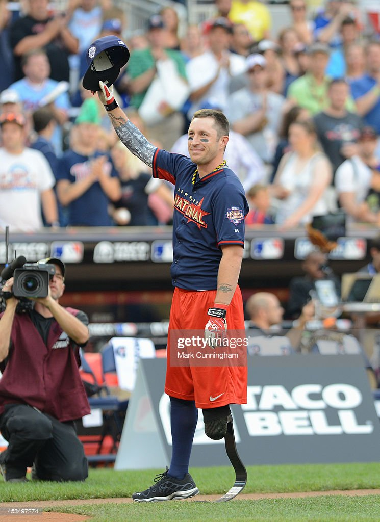 Wounded Warrior Amputee Softball Team member Nick Clark waves to the crowd prior to the 2014 Taco Bell MLB All-Star Legends & Celebrity Softball Game at Target Field on July 13, 2014 in Minneapolis, Minnesota.