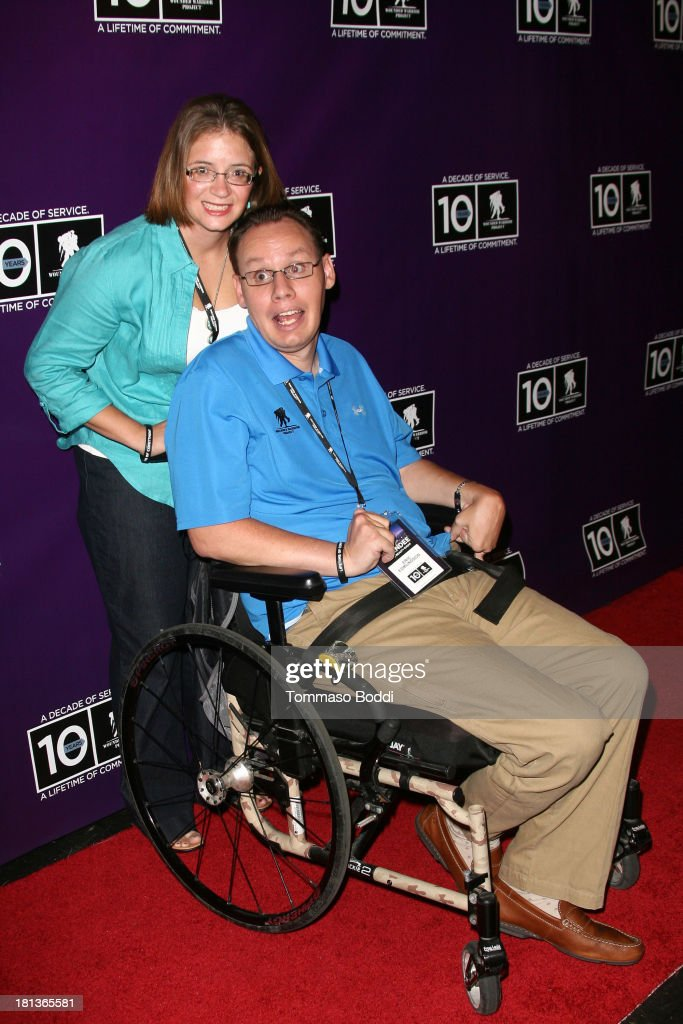 Wounded Warrior Eric Edmundson (R) and guest attend the Wounded Warrior Project style and beauty charity event held at Avalon on September 20, 2013 in Hollywood, California.