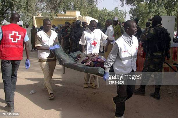 A wounded woman is carried on a stretcher on January 29 2016 in Mora following suicide attacks in the border city of Kerawa northern Cameroon A pair...