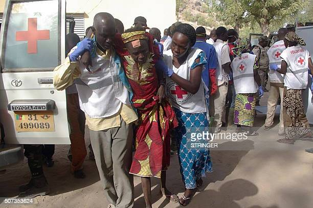 A wounded woman is evacuated by rescuers on January 28 2016 in Mora following suicide attacks in the border city of Kerawa northern Cameroon A pair...
