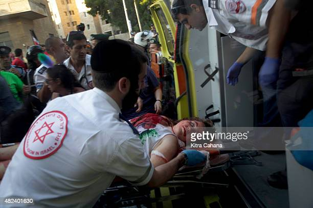 A wounded woman is placed on a stretcher after getting stabbed while marching in the gay pride parade on July 30 2015 in downtown Jerusalem Israel At...