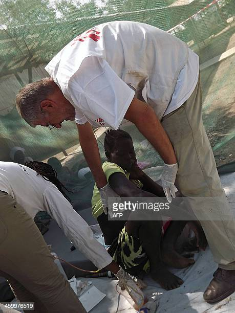 A wounded woman receives treatment at the Malakal Hospital in the Upper Nile State of South Sudan on December 31 2013 following heavy fighting in the...
