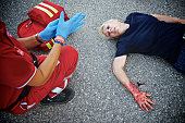 Wounded woman with paramedic