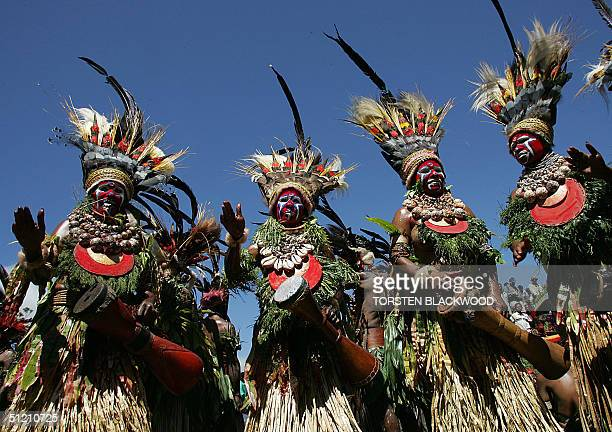 Woup Pokia women adorned in birdofparadise plumes and kina shells perform during the annual singsing cultural festival in Mount Hagen 15 August 2004...