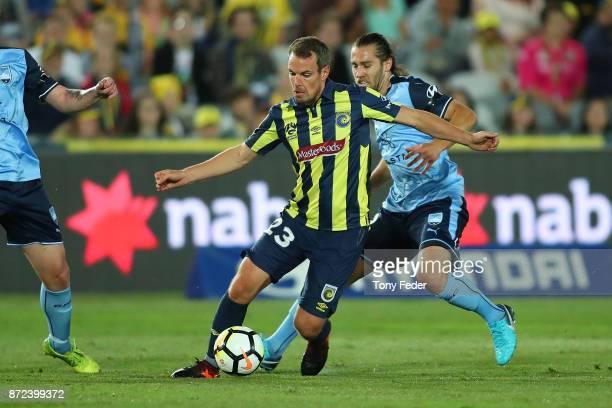 Wout Brama of the Mariners controls the ball from Joshua Brillante of Sydney during the round six ALeague match between the Central Coast Mariners...