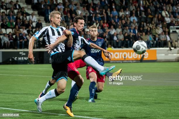 Wout Droste of Heracles Almelo Nick Viergever of Ajax during the Dutch Eredivisie match between Heracles Almelo and Ajax Amsterdam at Polman stadium...