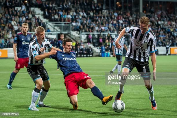 Wout Droste of Heracles Almelo Nick Viergever of Ajax Paul Gladon of Heracles Almelo during the Dutch Eredivisie match between Heracles Almelo and...