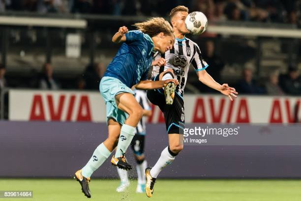 Wout Faes of Excelsior Paul Gladon of Heracles Almelo during the Dutch Eredivisie match between Heracles Almelo and sbv Excelsior at Polman stadium...