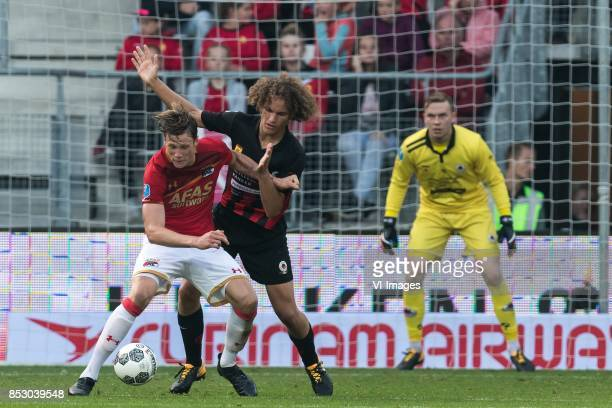 Wout Weghorst of AZ Wout Faes of Excelsior goalkeeper Ogmundur Kristinsson of Excelsior during the Dutch Eredivisie match between AZ Alkmaar and sbv...
