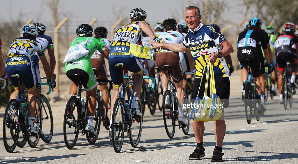 Wouter Mol of the Netherlands and Vacansoleil.dcm takes a musette from a team memeber as the peloton rides though the feed zone during stage four of the Tour of Qatar from Camel Race Track to Al Khor Corniche on February 6, 2013 in Al Khor Corniche, Qatar.