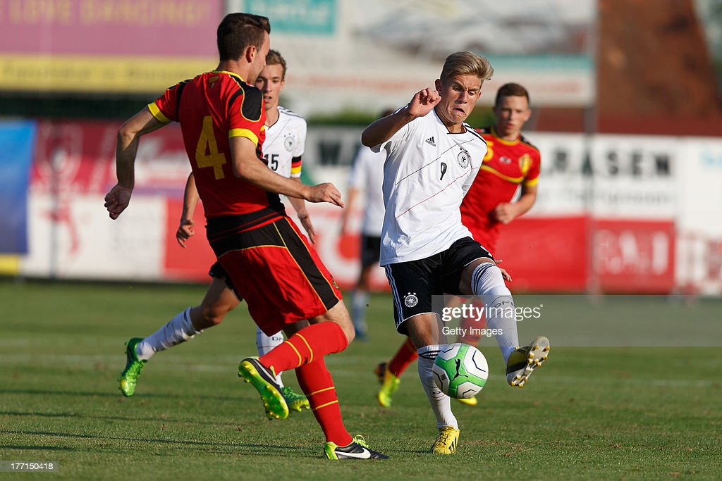 Wouters Dries of Belgium and Selke Davie of Germany compete for the ball during the U17 Toto-Cup match between Germany and Belgium on August 21, 2013 in Gleisdorf, Austria.