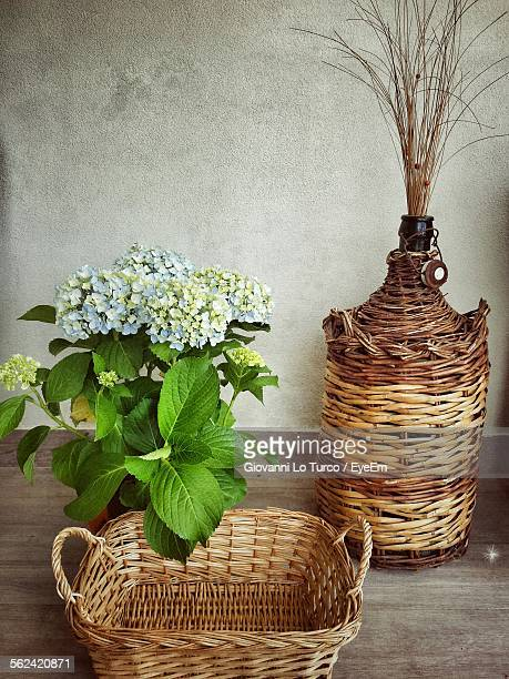 Woven Basket And Vase On Table