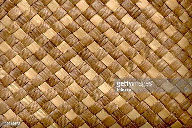 woven palm leaves in tan and brown