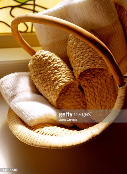 Woven Sisal Slippers and Towels in a Basket