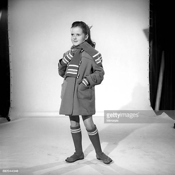School girl wearing winter coat scarf and socks November 1956 B591