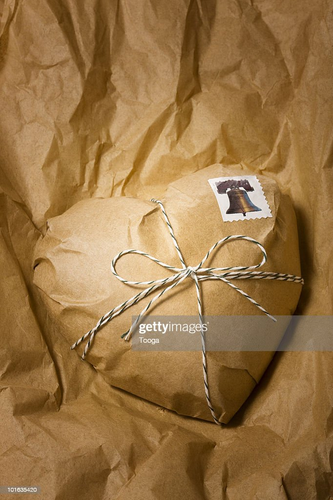 Wrapped brown paper package in the shape of heart : Stock Photo