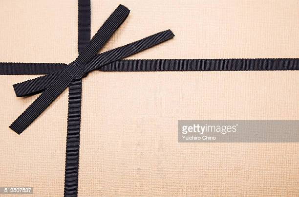 Wrapped gift box with black ribbon