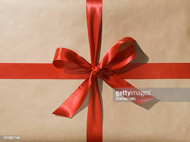 Wrapped Gift or Present with Red Ribbon Bow