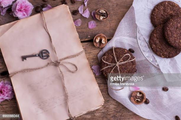 Wrapped old paler and brown cookies on wooden table