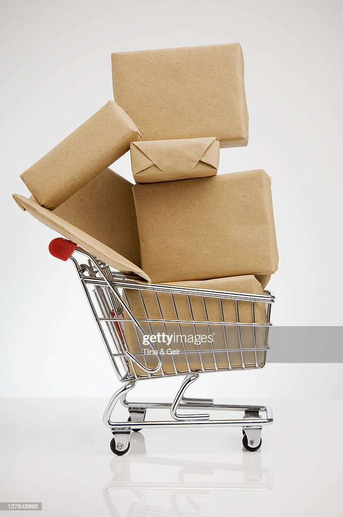 Wrapped packages in shopping cart : Stock Photo