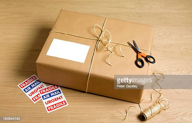 Wrapped parcel with string, scissors and stickers
