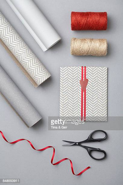 Wrapping paper, thread, card, scissors, ribbon