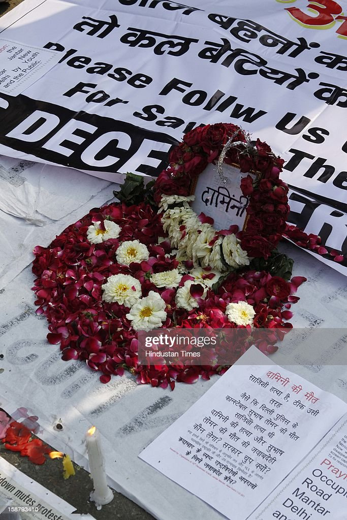 Wrath placed around written messages as Anti-Rape protesters gather to mourn the death of Rape victim girl at Jantar Mantar on December 29, 2012 in New Delhi, India. The nation was shocked in the morning after news of her death at the Singapore's Mount Elizabeth Hospital, where she was undergoing treatment. The Gang-rape of 23 year old girl in a moving bus enraged the entire country and galvanized people to demand for protection for women and justice for victims of such heinous crimes. There was heavy security deployment all around the city as many roads were blocked and metro stations were closed down to prevent any untoward incident.