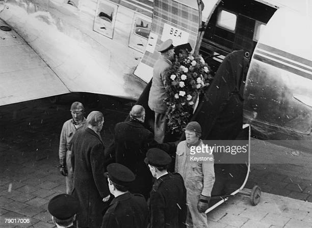 A wreath is carried aboard the aeroplane transporting the body of Manchester United player Duncan Edwards from Munich to manchester 22nd February...