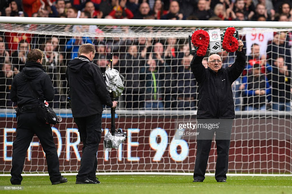 A wreath is carried by Barry Devonside, father of Hillsborough victim Christopher Devonside as the team's remember the 96 victims of the Hillsborough disaster during the Barclays Premier League match between Swansea City and Liverpool at The Liberty Stadium on May 1, 2016 in Swansea, Wales.