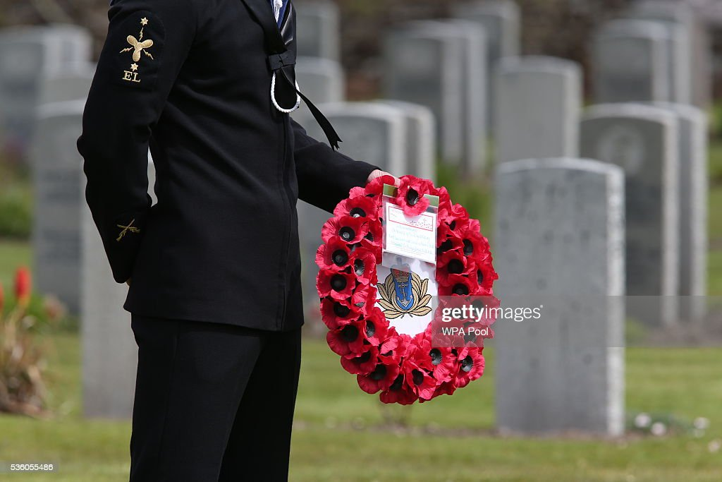 A wreath is held before being laid on behalf of the Royal Navy as descendants of those who fought at the Battle of Jutland attend a service at Lyness Cemetery during the 100th anniversary commemorations for the Battle of Jutland on May 31, 2016 in Hoy, Scotland. The event marks the centenary of the largest naval battle of World War One where more than 6,000 Britons and 2,500 Germans died in the Battle of Jutland fought near the coast of Denmark on 31 May and 1 June 1916.