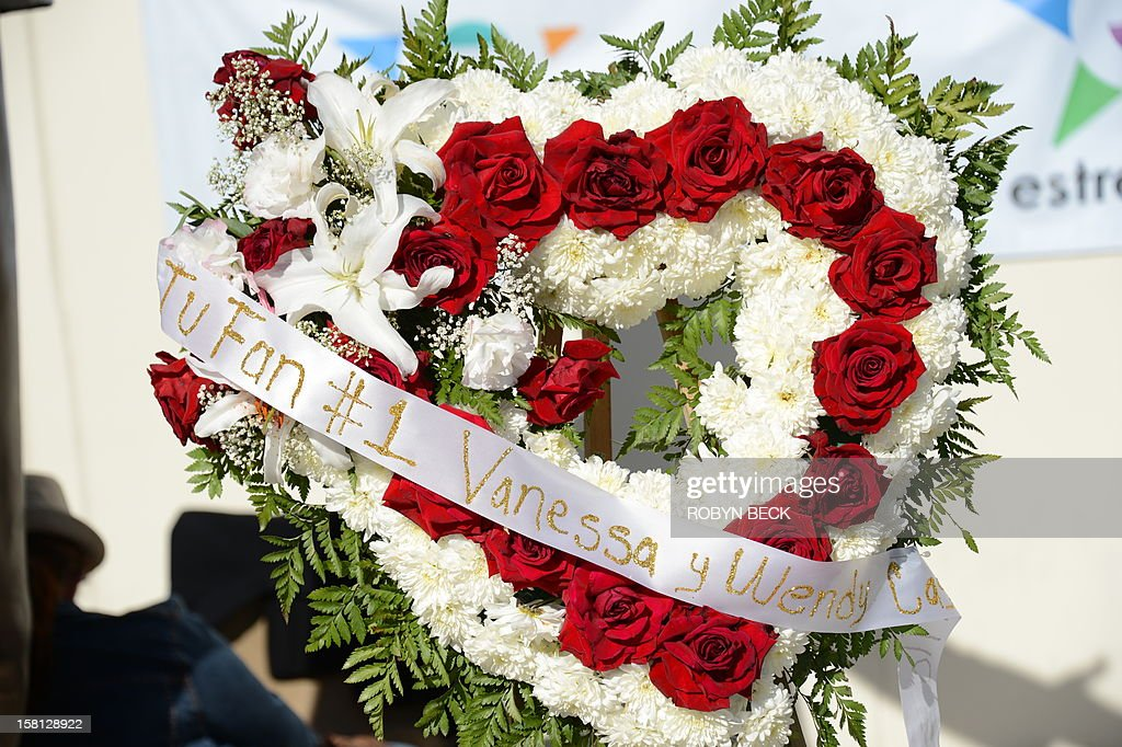 A wreath left by a fan at a memorial of flowers, candles, ballons and notes to the late Mexican-American singing superstar Jenni Rivera, December 10, 2012 in Burbank, California. Rescue workers searched Monday the wreckage of a plane that carried Rivera, a star on both sides of the border, whose death shocked Latin music fans and celebrities.
