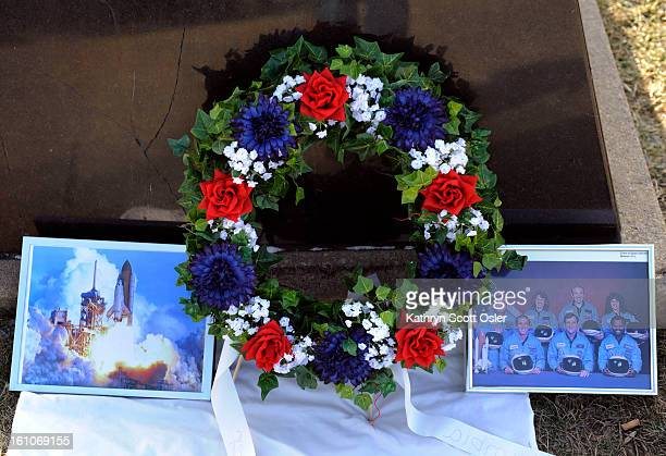 SPACE24_KSO_1_24_09080 A wreath of flowers and photographs of The Challenger and its crew are laid at The Challenger Memorial as the Arnold Air...