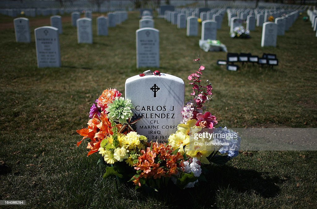 A wreath of flowers circles Iraq war veteran Marine Corporal Carlos J. Melendez's headstone on the 10th anniversary of the beginning of the war in Iraq at Arlington National Cemetery March 19, 2013 in Arlington, Virginia. The bombing of Baghdad by U.S. and coalition forces began on March 19, 2003.