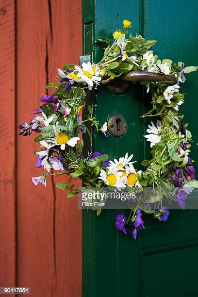 Wreath of flowers in midsummer on a doorhandle Sweden.
