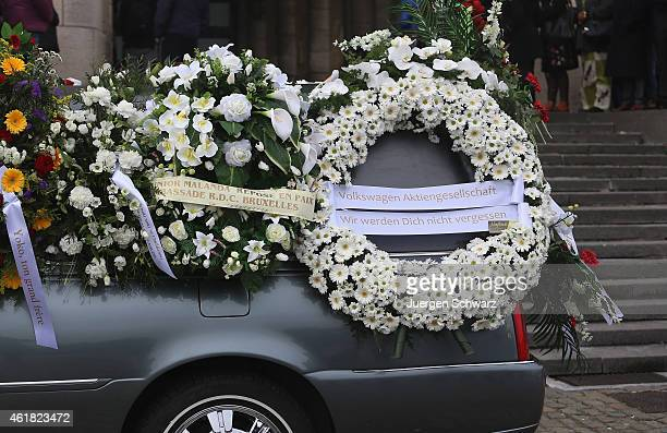 A wreath of Volkswagen AG car company reads ' We will not forget you' at the funeral service for soccer player Junior Malanda at Basilica of the...